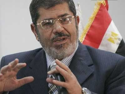 Mursi orders parliament to reconvene