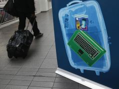 Britain lifts laptop ban on flights from Cairo